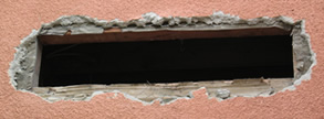 Stucco damage like this is often required if you choose new construction windows.